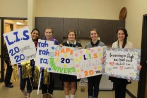 CDH students with signs